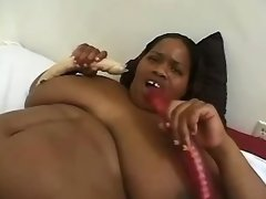 Two fat ebonies play with sex toys