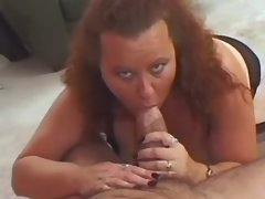 Mature fatty in lingerie sucks dick